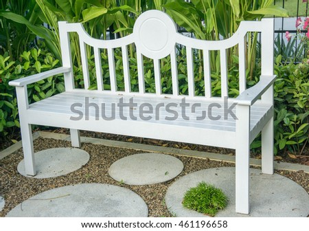 The white chair in the garden.