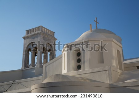 The white church on the top of Chora at the Naxos island at the Cyclades of the Aegean sea in Greece - stock photo