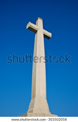 the white cross on the day of blue sky