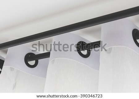 The white curtains with ring-top rail