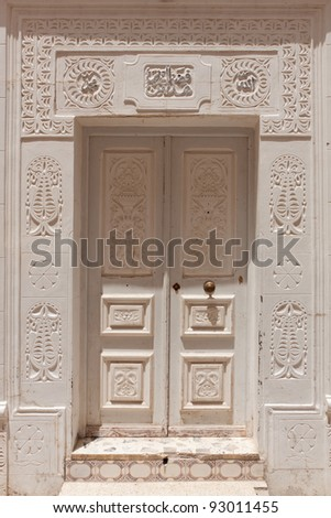 The white door with a carved pattern, Mahdia, Tunisia - stock photo