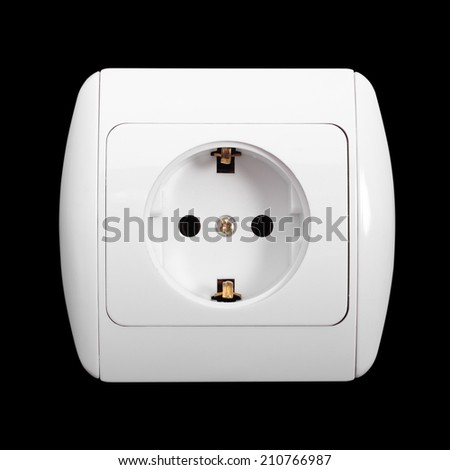 The white electric socket with grounding on a black background