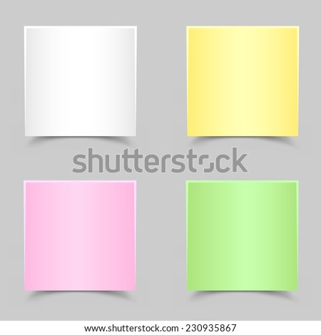 The white green yellow and pink papers with shadow on the gray background
