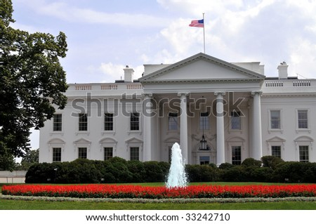The White House and its front lawn are seen here on U.S. Independence Day, July 4, 2009. - stock photo