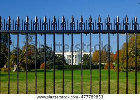 The White House as seen from behind of the iron fences - Washington DC, United States