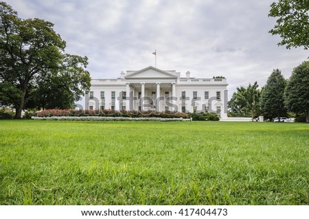 The White House in Washington D.C. at a cloudy day, green lawn in foreground, Executive Office of the President of the United States, USA