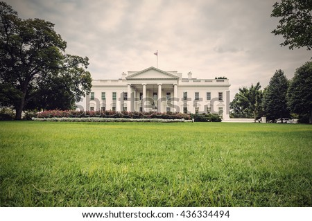 The White House in Washington D.C. at a cloudy day, green lawn in foreground, Executive Office of the President of the United States, USA, vintage filtered style - stock photo