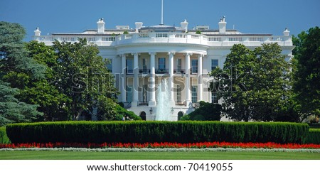 The White House in Washington DC with beautiful blue sky panorama