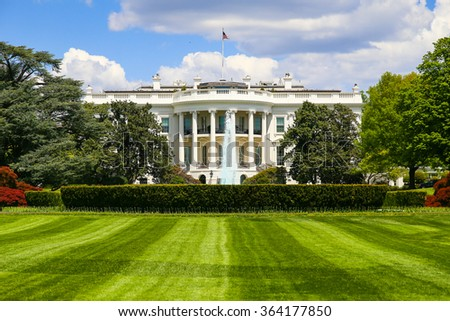 The White House with the fountain and the South lawn in front of it. - stock photo