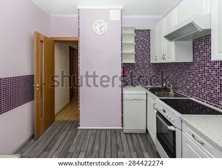 The white lilac interior kitchen room whith grey floor covering - stock photo