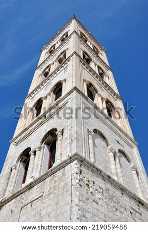 The white limestone bell tower of the Anastasia cathedral in Zadar, Croatia - stock photo