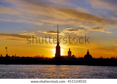 The White Nights of Saint Petersburg, Russia. The silhouette of Peter-and-Paul's Cathedral in Peter and Paul Fortress - stock photo