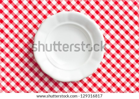 the white old plate on checkered napkin