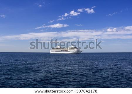 The white passenger ship sailing on the Mediterranean Sea - stock photo