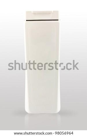 The white plastic shampoo bottle on the white gradient background - stock photo