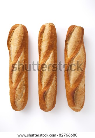 The whole bread on a white background. - stock photo