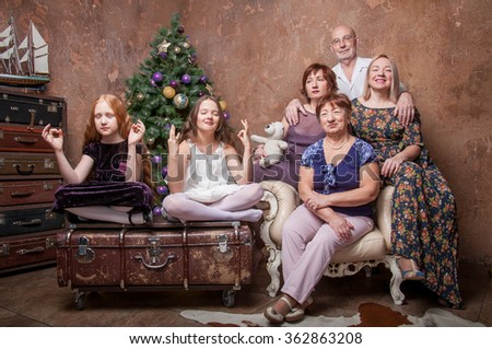 The whole family together smiling and happy - stock photo