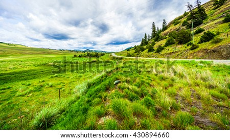 The wide open grasslands of the Nicola Valley between Kamloops and Merritt in British Columbia along Highway 5A.The area s home to some of the largest cattle ranches in North America - stock photo