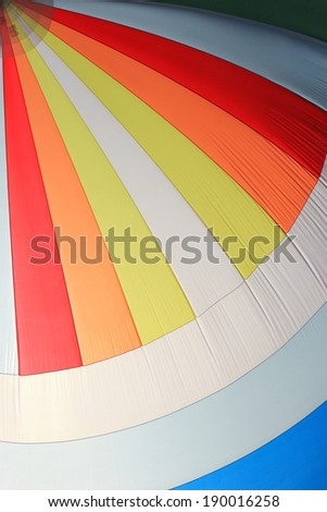 The wind has filled the spinnaker on sailing yacht. Detail of a colorful sail as background. - stock photo