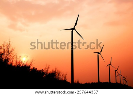 the wind turbine with the sunset