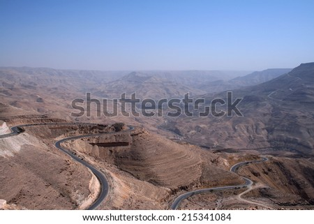 The winding King's road in Wadi Al Mujib valley, Jordan - stock photo
