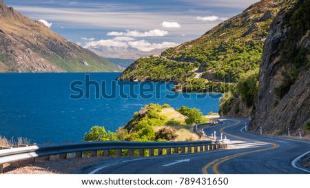 The winding road along the shore of Lake Wakatipu at Devils Staircase scenic lookout, not far from Queenstown, in the Southern Island of New Zealand.