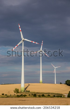 The windmills in high mountains Alps Austria - stock photo