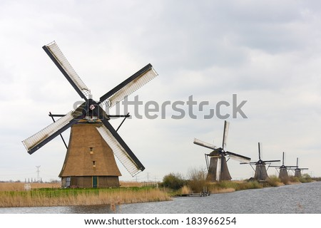 The 19 windmills of Kinderdijk are one of the best-known Dutch tourist sites. - stock photo
