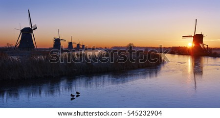 The windmills of Kinderdijk at sunrise on a winterday, the Netherlands