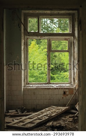 the window of an abandoned building with garbage