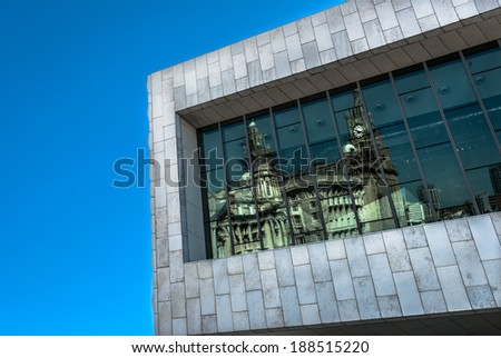 The window of the museum of Liverpool reflecting the Liver Buildings. - stock photo
