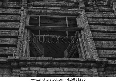 The window of the old creepy abandoned scary house in which lives a Ghost and a murder - stock photo