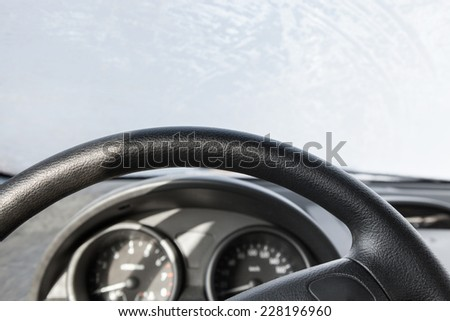 The windshield frozen car kind from within - stock photo