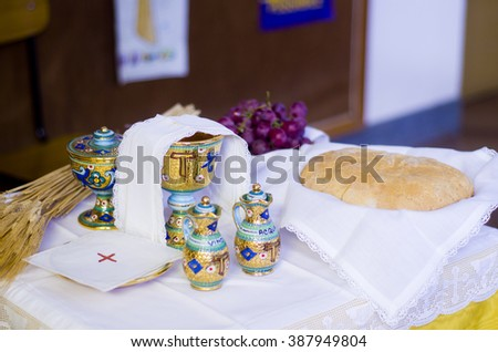 The wine and the bread become the blood and body of Christ - stock photo
