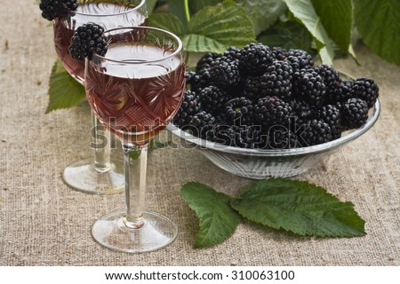The wine is very tasty with blackberries - stock photo