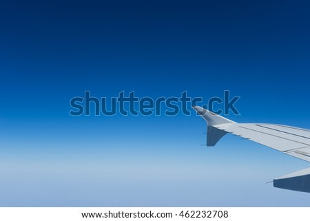 the wing of the plane on blue sky background