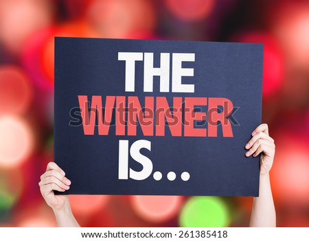 The Winner Is... card with bokeh background - stock photo
