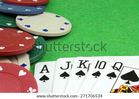 The winning combination royal flush in poker background - stock photo