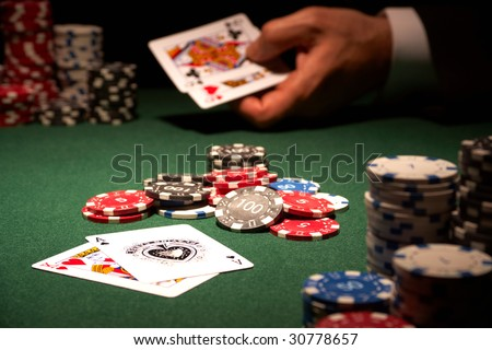 The winning hand blackjack casino card game showing chips on green felt background - stock photo