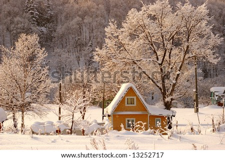 The Winter morning in village. The Ascendant sun has painted the snow in rose color. - stock photo