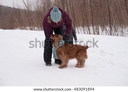 The winter of 2015, the village Kamenushka, Russia. A woman warms her dog scarf.