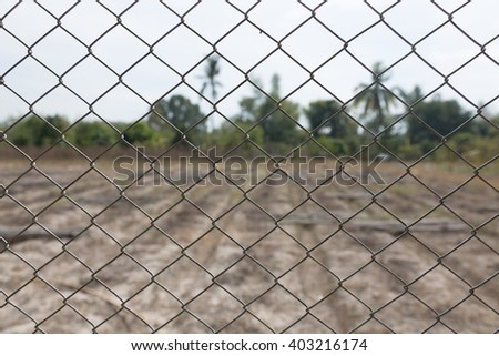 The wire fence those separate inside from the drought and dry outside cause by climate change.