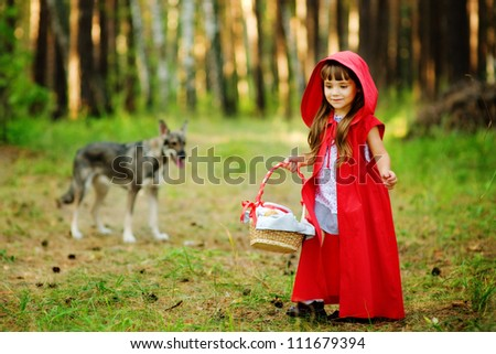 "the wolf pursues the girl.  the fairy tale "" Red Riding Hood"" - stock photo"