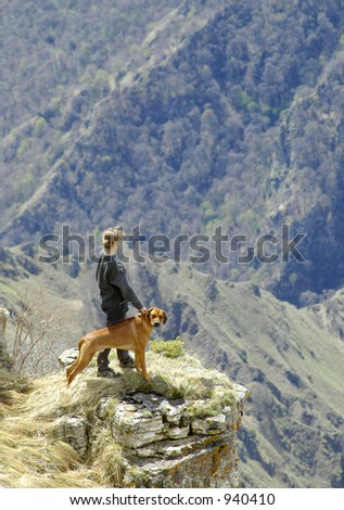 The woman and the dog stay above a precipice - stock photo