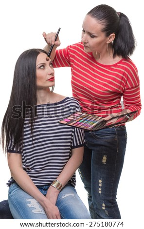 The woman does a make-up  - stock photo