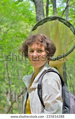 The woman entomologist with butterfly-net. - stock photo
