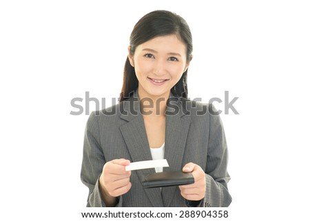 The woman exchanges the business cards - stock photo
