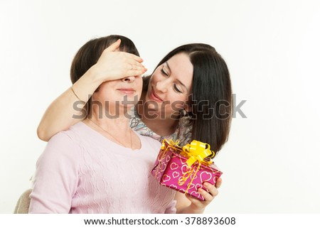 the woman gives to mother a gift - stock photo