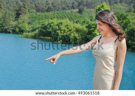 The woman hand point out to lake in the Turkey.