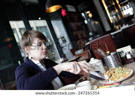 The woman has lunch in the restaurant - stock photo